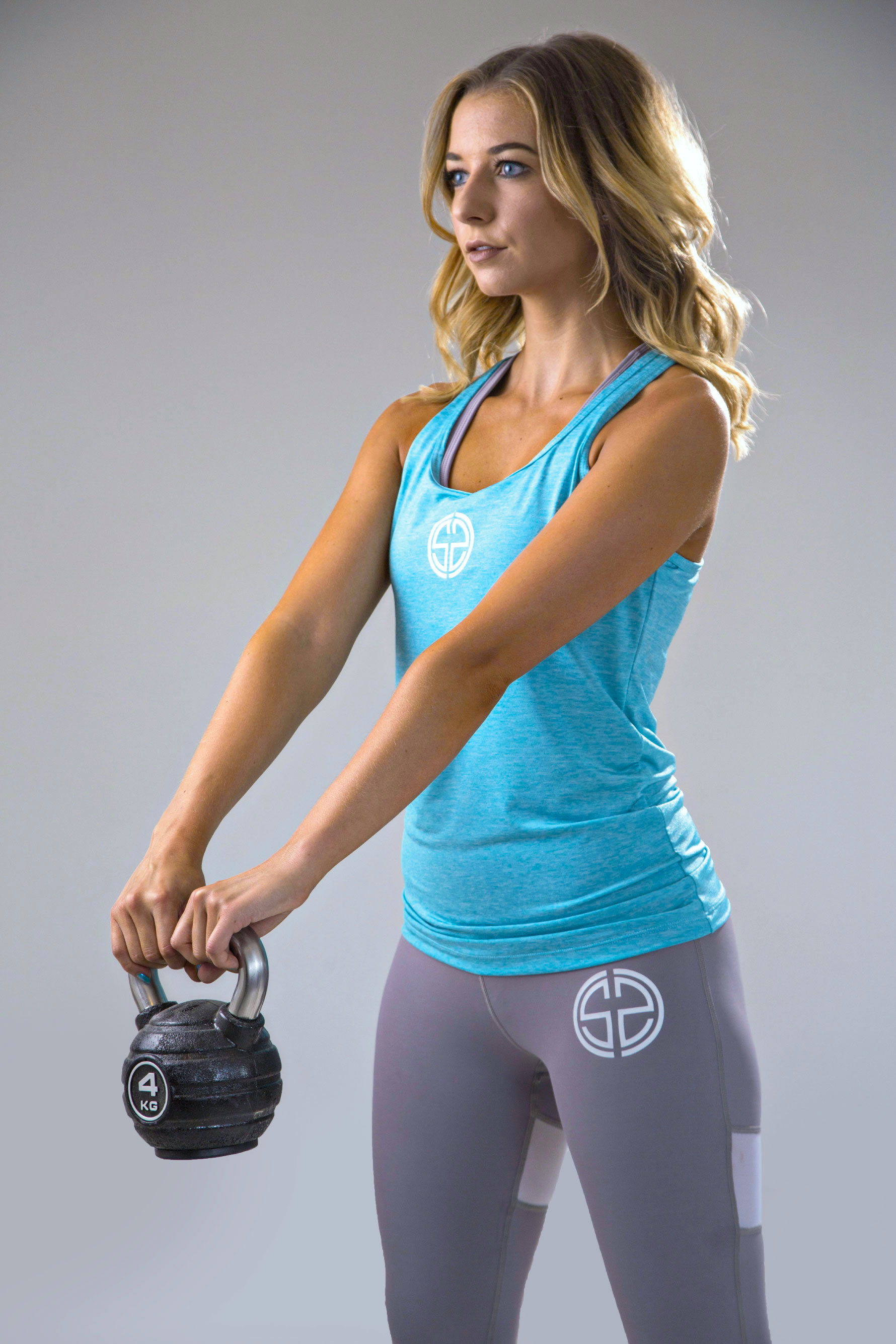 womens dry fit vest in teal 1 | womens high waisted leggings in grey | Symmetry Athletics