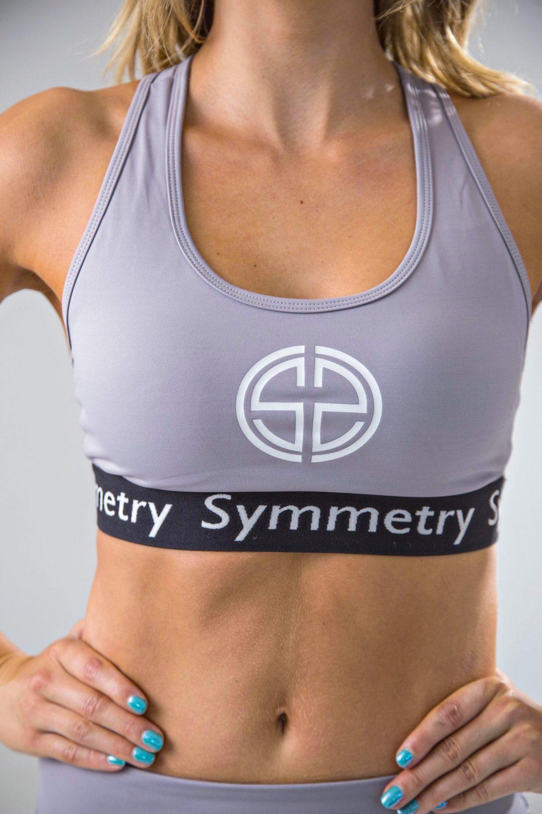 womens sports bra in grey and black | symmetry athletics