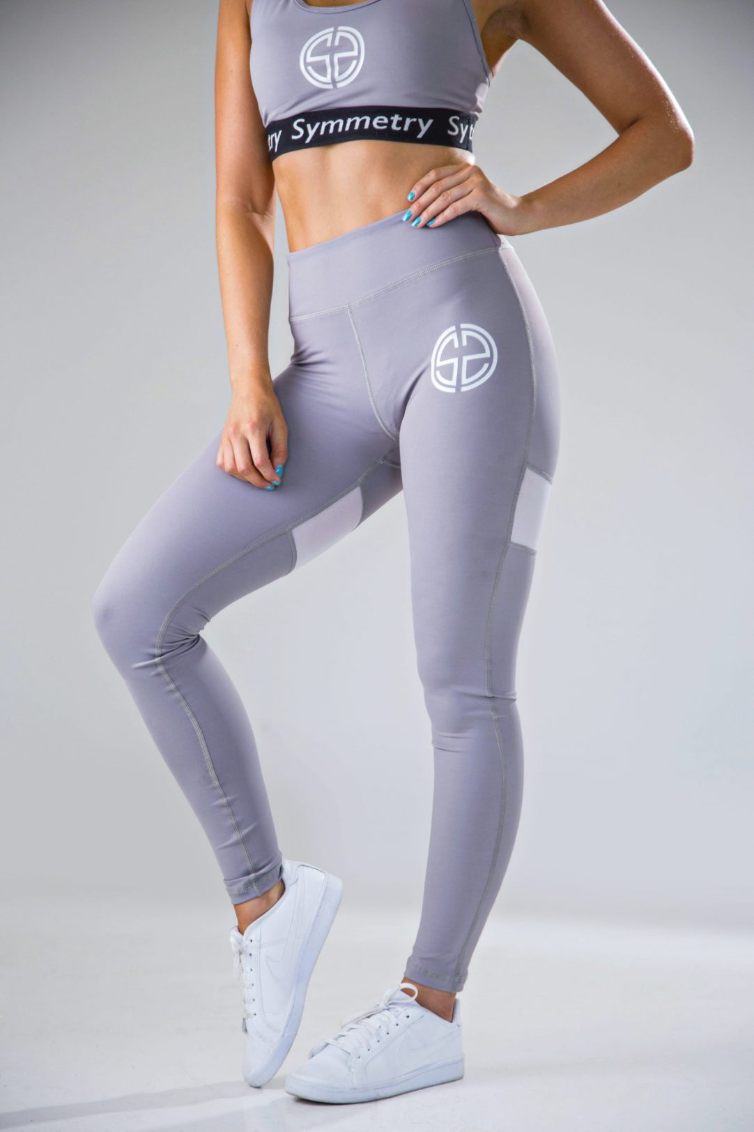 womens high waisted leggings in grey with mesh panels 2 | womens sports bra in grey | symmetry athletics